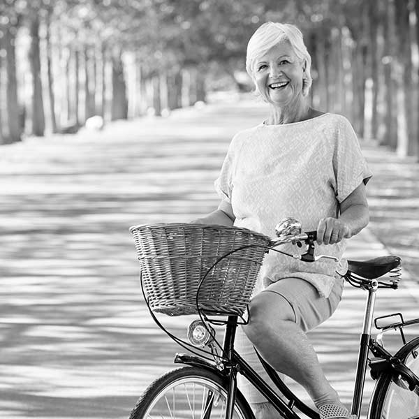 Photo of a senior woman on a bicycle