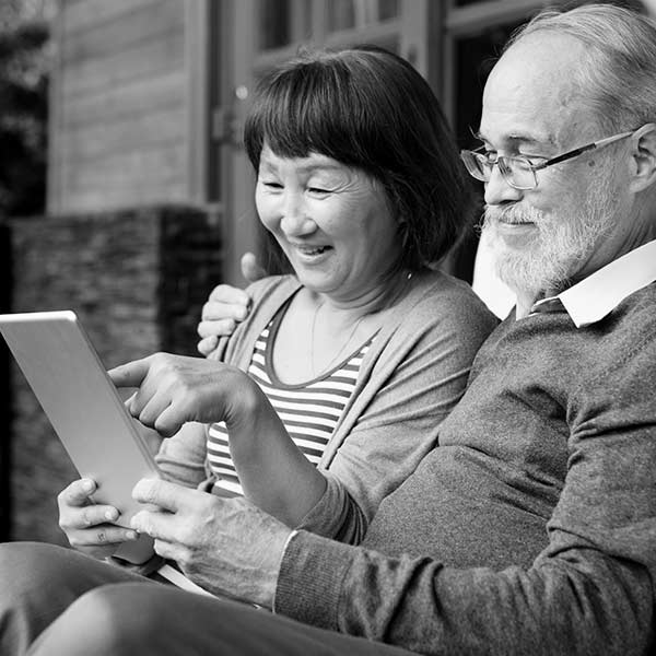 Photo of a senior couple viewing a tablet